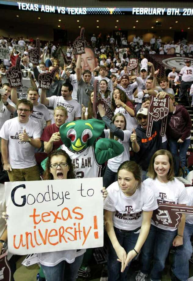 Bridget Hendricks, left, a senior from Tampa, Fla., yells as she holds her sign before the Texas A&M and Texas NCAA basketball game, Monday, Feb. 6, 2012, in Reed Arena in College Station. Texas A&M is leaving for the SEC possibly making this last game in the foreseeable future. Photo: Nick De La Torre, Houston Chronicle / © 2012  Houston Chronicle