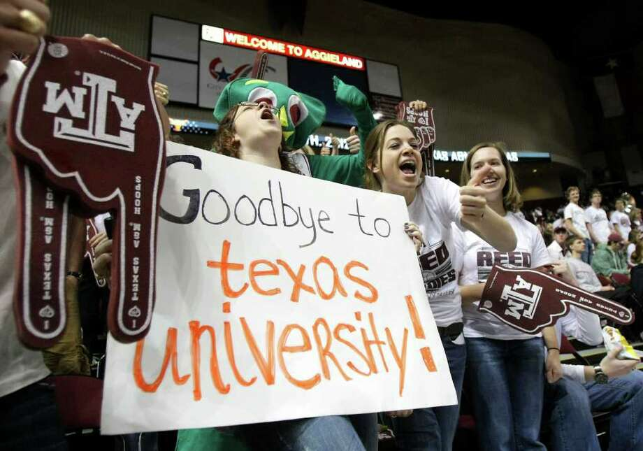 Bridget Hendricks, left, a senior from Tampa, Fla., holds her sign and yells with her friend Kassandra White, of Prattville, Al., before the Texas A&M and Texas NCAA basketball game, Monday, Feb. 6, 2012, in Reed Arena in College Station. Texas A&M is leaving for the SEC possibly making this last game in the foreseeable future. Photo: Nick De La Torre, Houston Chronicle / © 2012  Houston Chronicle