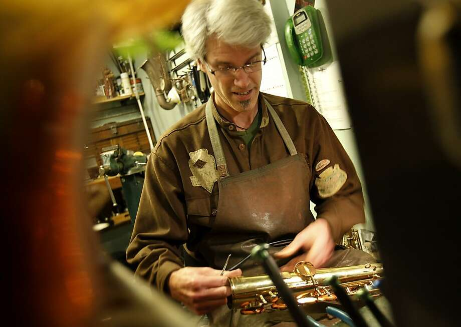 Eric Drake repairs saxophones and is also an accomplished musician. Eric Drake runs a full service repair shop for saxophones called Saxcraft on University Avenue in Berkeley, Calif. Photo: Brant Ward, The Chronicle