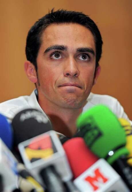 PINTO, SPAIN - FILE:  Alberto Contador listens to questions from the media during his press conference pleading his innocence after being tested positive for clenbuterol, a fat-burning and muscle-building drug, during this year's Tour de France, on September 30, 2010 in Pinto, Spain. According to the Spanish cycling federation Alberto Contador has been banned for two years by the court of arbitration for sport after rejecting his claim that his positive test for clenbuterol was caused by eating contaminated meat while during the 2010 Tour de France. This decision will strip 2010 Tour de France and 2011 Giro D'Italia champion of his titles.  (Photo by Jasper Juinen/Getty Images) Photo: Jasper Juinen / 2010 Getty Images