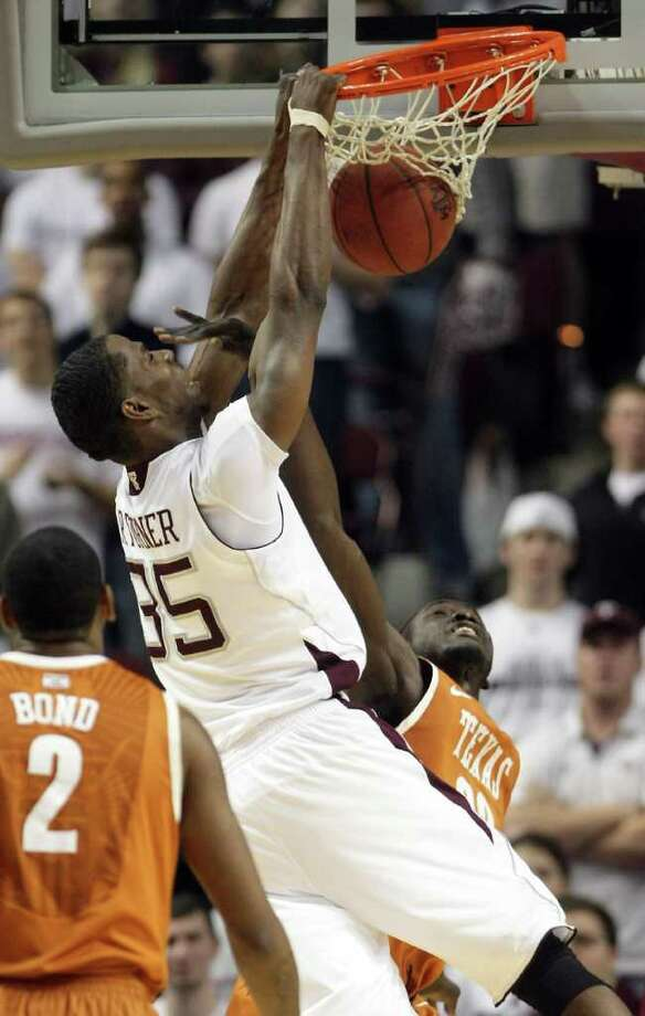 Texas A&M forward Ray Turner (35) slams the ball over Texas forward/center Alexis Wangmene (20) during the first half of a NCAA basketball game, Monday, Feb. 6, 2012, in Reed Arena in College Station Photo: Nick De La Torre, Houston Chronicle / © 2012  Houston Chronicle
