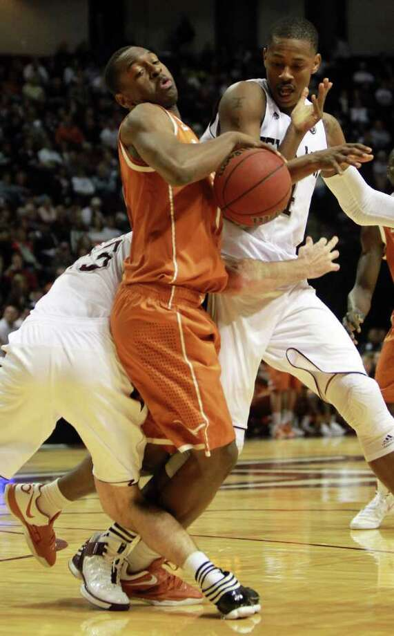 Texas guard Sheldon McClellan (1), center,  gets tangled up by Texas A&M guard/forward Zach Kinsley (23), left, and center Keith Davis (4) as he tries to break the full court press during the first half of a NCAA basketball game, Monday, Feb. 6, 2012, in Reed Arena in College Station Photo: Nick De La Torre, Houston Chronicle / © 2012  Houston Chronicle