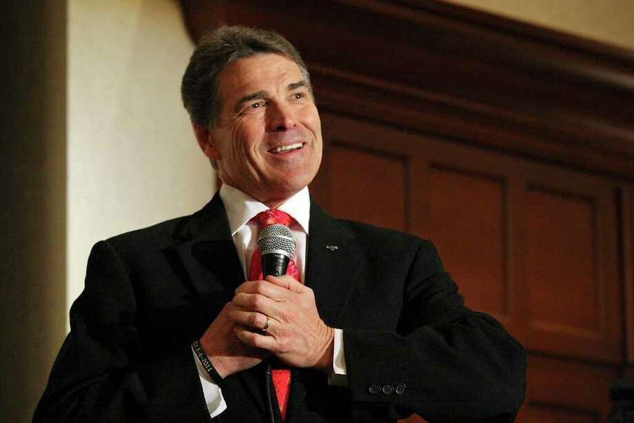 Gov. Rick Perry has found refuge in recent court rulings rejecting  the need for him to disclose security costs for personal and official  travel. Photo: EDWARD A. ORNELAS, SAN ANTONIO EXPRESS-NEWS / © SAN ANTONIO EXPRESS-NEWS (NFS)