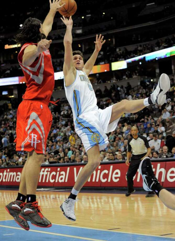 Denver Nuggets forward Danilo Gallinari (8) from Italy shoots against Houston Rockets forward Luis Scola (4) during the third quarter of an NBA basketball game on Monday, Feb. 6, 2012, in Denver. (AP Photo/Jack Dempsey) Photo: Jack Dempsey, Associated Press / FR42408 AP