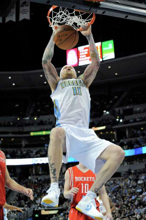 Denver Nuggets center Chris Andersen (11) dunks against the Houston Rockets during the third quarter of an NBA basketball game on Monday, Feb. 6, 2012, in Denver. (AP Photo/Jack Dempsey) Photo: Jack Dempsey, Associated Press / FR42408 AP