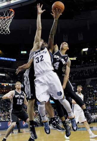 Memphis Grizzlies guard O.J. Mayo (32) shoots under pressure by San Antonio Spurs forward Danny Green (4) and San Antonio Spurs guard Cory Joseph (5 )in the second half of an NBA basketball game on Monday, Feb. 6, 2012, in Memphis, Tenn. Photo: AP