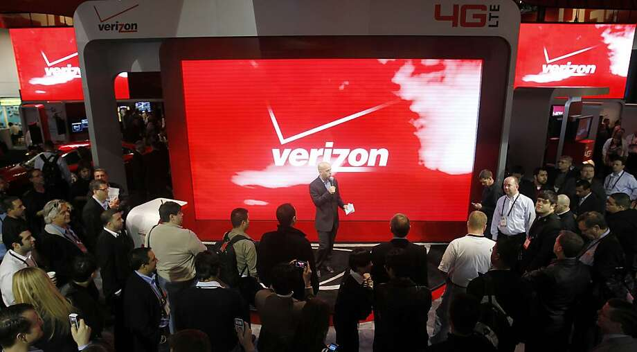 In this Jan. 6, 2012 photo, attendees check out the unveiling of 4G devices at the Verizon booth during the Consumer Electronics Show, in Las Vegas. Challenging Netflix, Verizon said Monday, Feb. 6, 2012, it will start a video streaming service later this year in cooperation with Redbox and its DVD rental kiosks. (AP Photo/Isaac Brekken) Photo: Isaac Brekken, Associated Press