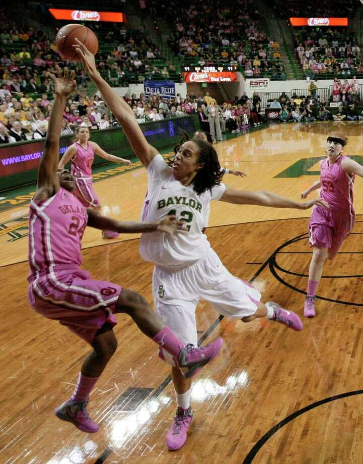 Baylor 's Brittney Griner (42) blocks a shot attempt by Oklahoma 's Sharane Campbell (24) in the first half of an NCAA women's college basketball game Monday, Feb. 6, 2012, in Waco, Texas. (AP Photo/Tony Gutierrez) Photo: Tony Gutierrez / AP