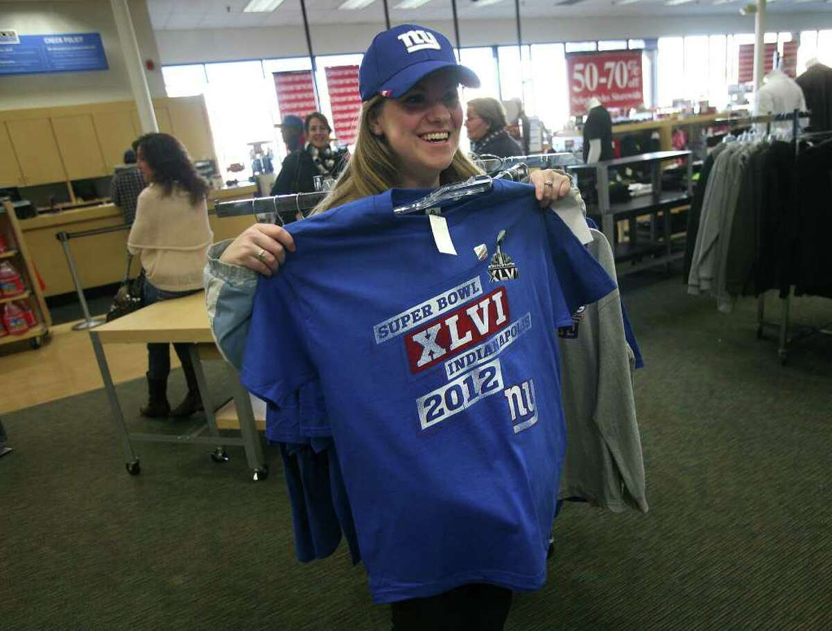 Molly Clifford of Milford checks out a New York Giants Super Bowl tee shirt at Bob's on Cherry Street in Milford on Monday, February 6, 2012.