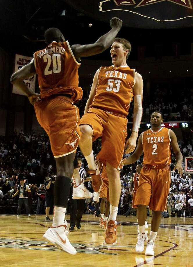 Texas forward/center Alexis Wangmene (20) and Texas forward/center Clint Chapman (53) celebrate after beating Texas A&M 70-68 in a NCAA basketball game, Monday, Feb. 6, 2012, in Reed Arena in College Station. Texas won 70-68. Photo: Nick De La Torre, Houston Chronicle / © 2012  Houston Chronicle