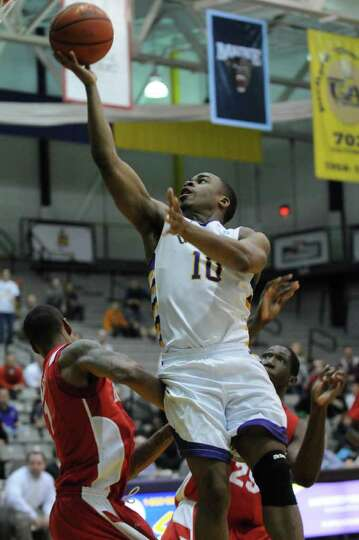 UAlbany's Mike Black drives to the basket during the second half of UAlbany's 81-78 loss to Boston U