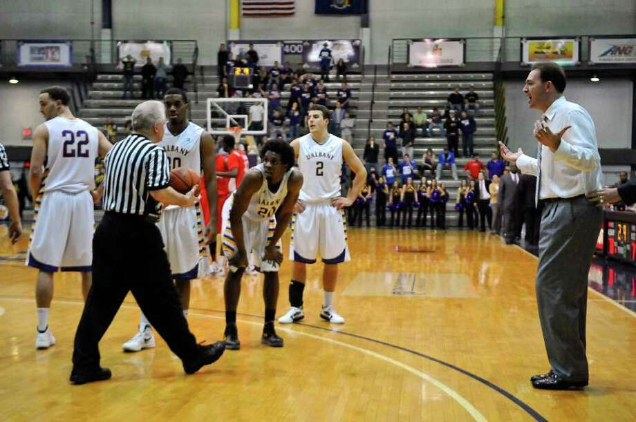 UAlbany coach Will Brown, right, pleads with a referee in the closing moments of the second half of UAlbany's 81-78 loss to Boston University at the SEFCU Arena on Monday night Feb. 6, 2012 in Albany, NY.   UAlbany was leading by 17  at one point late in the first half.  (Philip Kamrass / Times Union ) Photo: Philip Kamrass / 00016316A