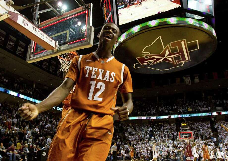 Texas guard Myck Kabongo (12) celebrates as the buzzer goes off signaling the end of his game against Texas A&M after a NCAA basketball game, Monday, Feb. 6, 2012, in Reed Arena in College Station. Texas won 70-68. Photo: Nick De La Torre, Houston Chronicle / © 2012  Houston Chronicle