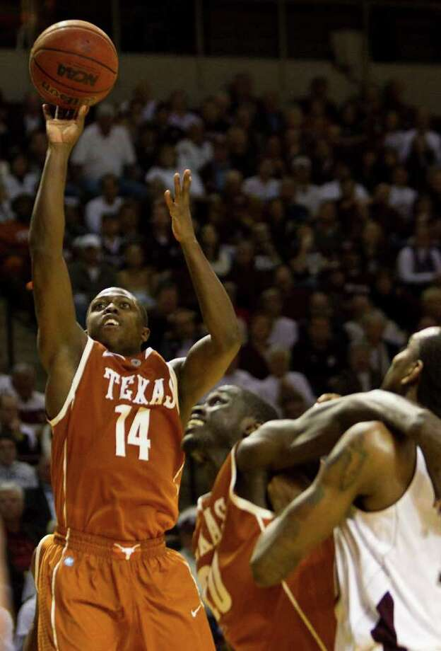 Texas guard J'Covan Brown (14) shoots an easy jumper for a basket during the second half of a NCAA basketball game against Texas A&M, Monday, Feb. 6, 2012, in Reed Arena in College Station. Texas won 70-68. Photo: Nick De La Torre, Houston Chronicle / © 2012  Houston Chronicle