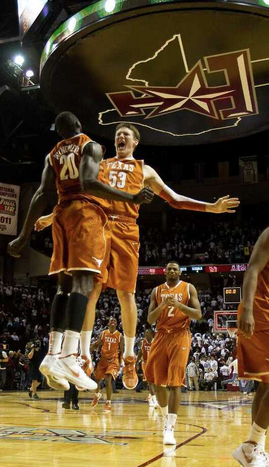 Feb. 6: Texas 70, Texas A&M 68 - Texas' Alexis Wangmene (20) and Clint Chapman (53) celebrate after beating Texas A&M on Monday night at Reed Arena in College Station.  Photo: Nick De La Torre, Houston Chronicle / © 2012  Houston Chronicle