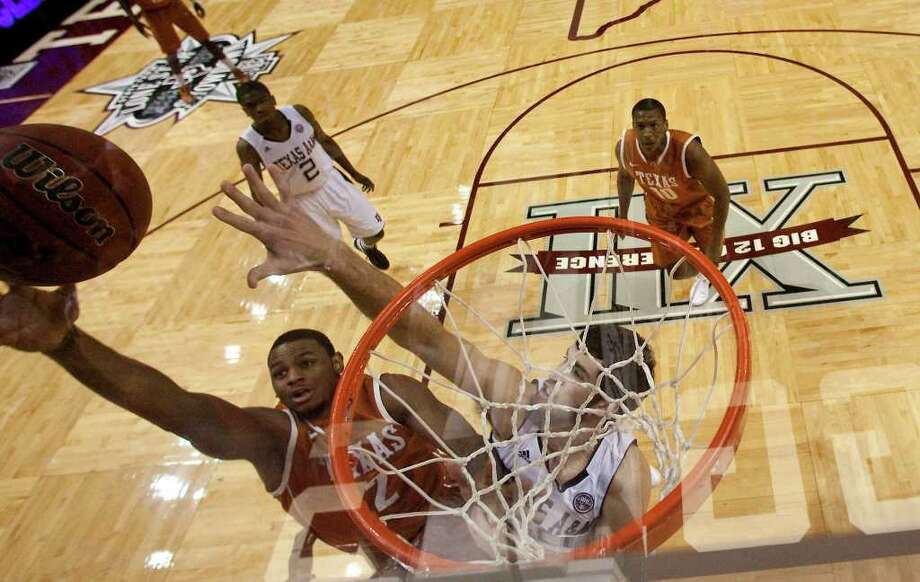 Texas forward Jaylen Bond (2) puts up a shot past Texas A&M forward Daniel Alexander (20) during the first half of a NCAA basketball game, Monday, Feb. 6, 2012, in Reed Arena in College Station. Texas won 70-68. Photo: Nick De La Torre, Houston Chronicle / © 2012  Houston Chronicle