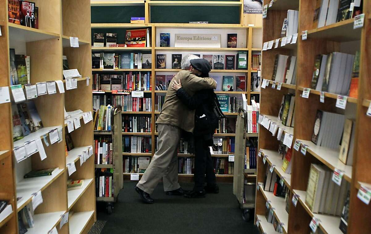 Clark Kepler, the last Kepler to run Kepler's Bookstore in Menlo Park gets a hug from former store volunteer pia Hattiangdi on his last day before retirement Tuesday, January 31, 2012