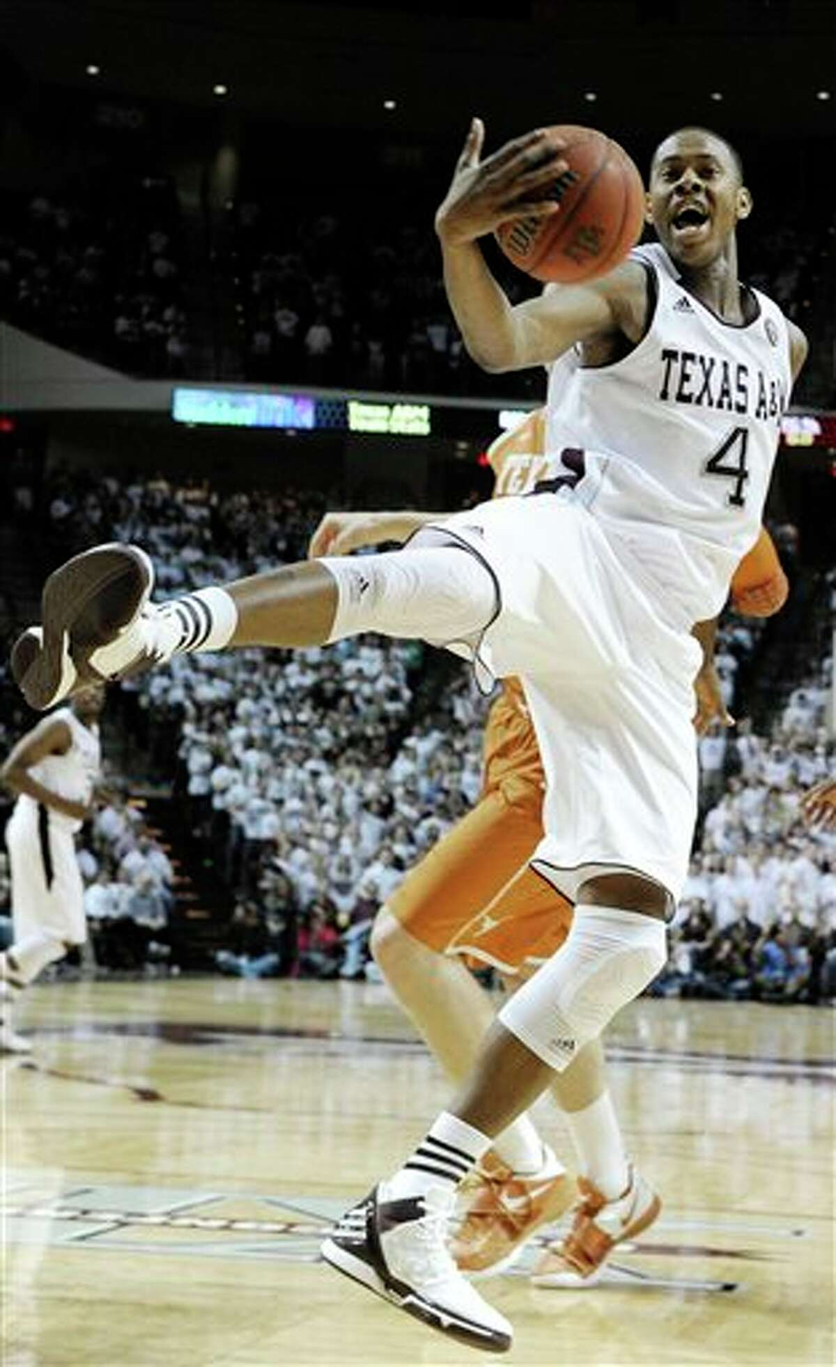 Texas A&M's Keith Davis (4) grabs a rebound during the first half of an NCAA college basketball game against Texas on Monday, Feb. 6, 2012, in College Station, Texas. (AP Photo/Pat Sullivan)