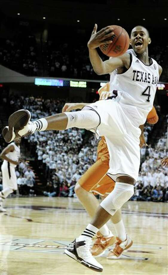 Texas A&M's Keith Davis (4) grabs a rebound during the first half of an NCAA college basketball game against Texas on Monday, Feb. 6, 2012, in College Station, Texas. (AP Photo/Pat Sullivan) Photo: Pat Sullivan, Associated Press / AP