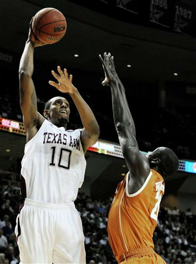 Texas A&M's David Loubeau (10) shoots over Texas' Alexis Wangmene in the first half of an NCAA college basketball game Monday, Feb. 6, 2012, in College Station, Texas. (AP Photo/Pat Sullivan) Photo: Pat Sullivan, Associated Press / AP