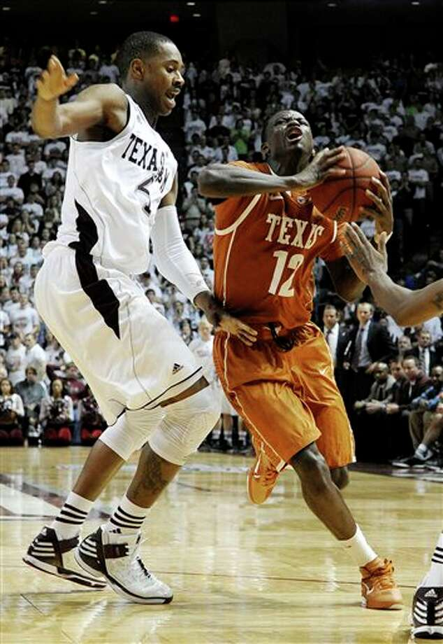 Texas' Myck Kabongo (12) works against Texas A&M's Keith Davis (4) in the second half of an NCAA college basketball game Monday, Feb. 6, 2012, in College Station, Texas. Texas won 70-68. (AP Photo/Pat Sullivan) Photo: Pat Sullivan, Associated Press / AP