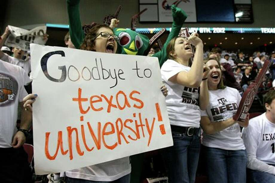 Bridget Hendricks, left, a senior from Tampa, Fla., yells as she holds her sign before an NCAA college basketball game between Texas and Texas A&M, Monday, Feb. 6, 2012, at Reed Arena in College Station, Texas. Texas A&M is leaving for the Southeastern Conference. (AP Photo/Houston Chronicle, Nick de la Torre) MANDATORY CREDIT Photo: Nick De La Torre, Associated Press / © 2012  Houston Chronicle