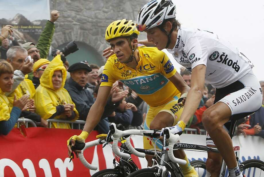 FILE - This is a  July 22, 2010, file photo shows stage winner Andy Schleck of Luxembourg, right, and Alberto Contador of Spain, wearing the overall leader's yellow jersey, crossing the finish line of 17th stage of the Tour de France cycling race over 174 kilometers (108.1 miles) with start in Pau and finish on Tourmalet pass, Pyrenees region, France.  Contador was stripped of his 2010 Tour de France title Monday and banned for two years after sport's highest court found the Spanish cyclist guilty of doping. The Court of Arbitration for Sport suspended the three-time Tour champion after rejecting his claim that his positive test for clenbuterol was caused by eating contaminated meat on a 2010 Tour rest day. Andy Schleck of Luxembourg, who finished second at the 2010 Tour, stands to be elevated to the top spot. (AP Photo/Laurent Rebours, file) Photo: Laurent Rebours, Associated Press