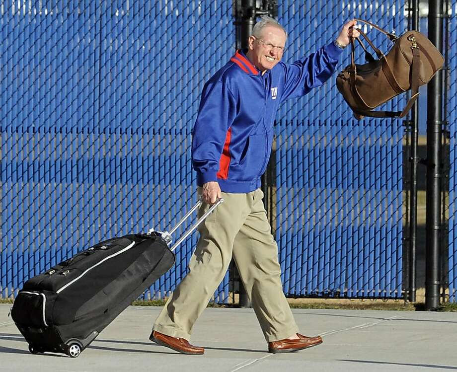 New York Giants coach Tom Coughlin waves to fans at the Giants NFL football training facility Monday, Feb. 6, 2012, in East Rutherford, N.J. A day earlier, the Giants defeated the New England Patriots in Super Bowl XLVI. (AP Photo/Bill Kostroun) Photo: Bill Kostroun, Associated Press