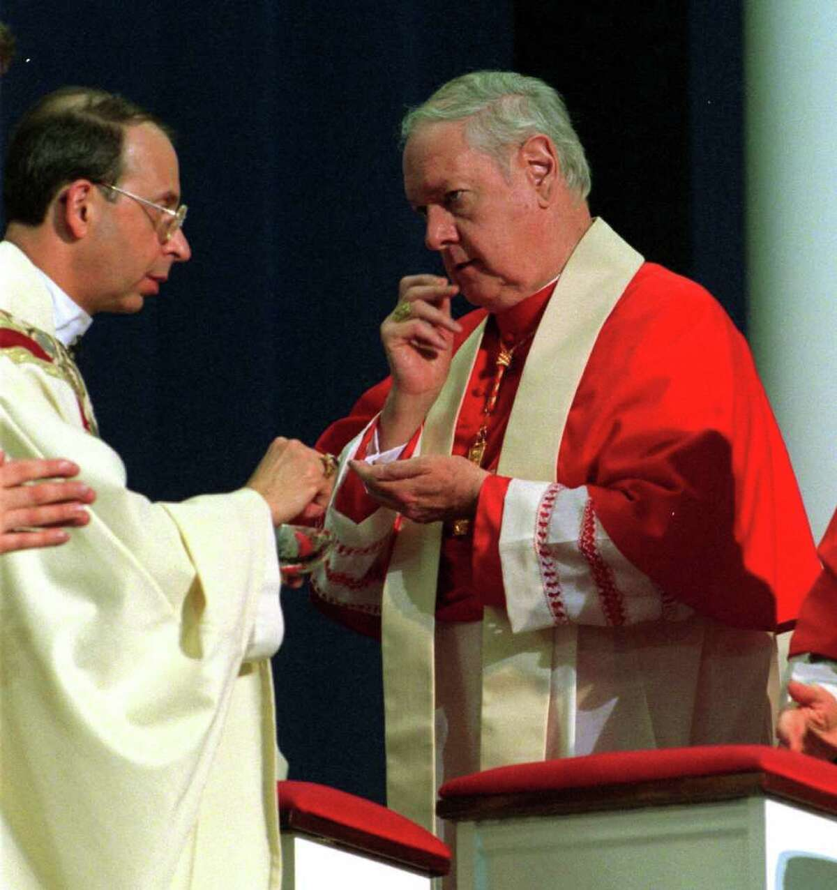 Cardinal Edward Michael Egan receives communion from his succesor Bishop William E. Lori during Lori's installation as the fourth Bishop of Bridgeport at Sacred Heart University, in Fairfield, Conn. on March 19th, 2001. In the recent edition of Connecticut Magazine Egan claims that while bishop in Bridgeport, Conn. he did nothing wrong regarding abuse allegation against priests in the diocese and in fact never had a case of alleged abuse while he was bishop. In the interview Egan also expressed regret for the apology he made regarding the priest scandal here.