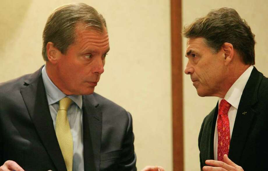 Lt. Gov. David Dewhurst (left) has been endorsed by Gov. Rick Perry for U.S. Senate. Perry has slammed tea party groups supporting Dewhurst's opponent Ted Cruz. Photo: Express-News File Photo / © SAN ANTONIO EXPRESS-NEWS (NFS)