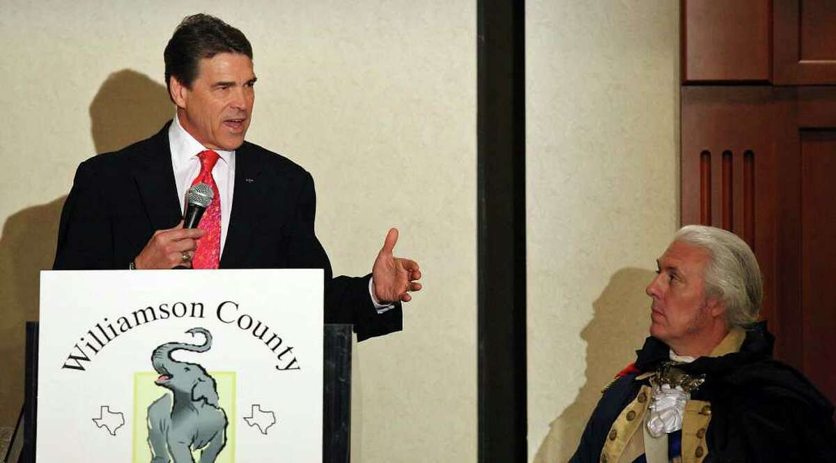 FOR METRO - Governor Rick Perry (left) speaks, Monday Feb. 6, 2012, as impersonator Mark Collins dressed as George Washington listens during the Williamson County Republican Party's annual Reagan Dinner held at the Marriott Austin North in Round Rock, Tx.