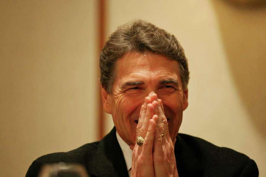 FOR METRO - Governor Rick Perry laughs, Monday Feb. 6, 2012,  during the Williamson County Republican Party's annual Reagan Dinner held at the Marriott Austin North in Round Rock, Tx. Photo: EDWARD A. ORNELAS, SAN ANTONIO EXPRESS-NEWS / © SAN ANTONIO EXPRESS-NEWS (NFS)