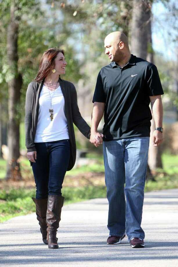 Mandy Love and fiancé Jason Walsh enjoy a Saturday walk together at Meyer Park. Photo: Thomas Nguyen / Freelance