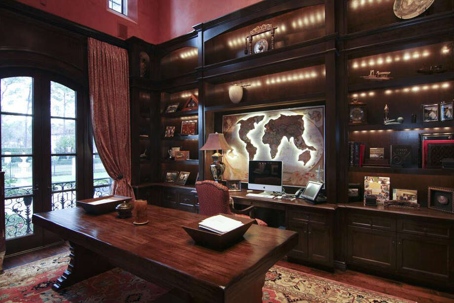 The study is filled with built-in book shelves and cabinetry. Photo: Realtor.com