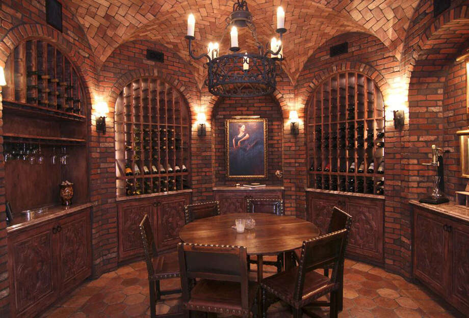 The wine room offers numerous shelves and cabinets for the storage of your favorite reds and whites. Photo: Realtor.com