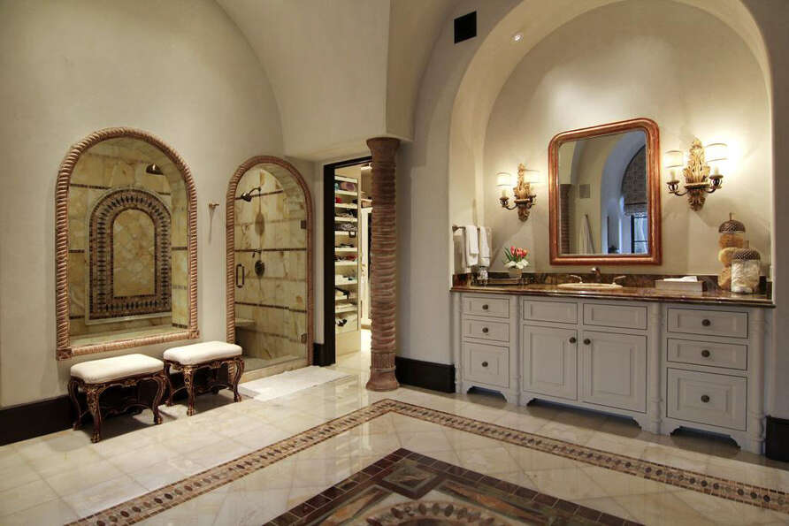The master bathroom also features a sitting area as well as a vanity, shower and walk-in closet.