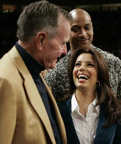 Actress Eva Longoria shares a laugh with former President George H. W. Bush before the NBA All-Star basketball game in Houston, Sunday, Feb. 19,  2006. Photo: L.M. OTERO, AP / AP