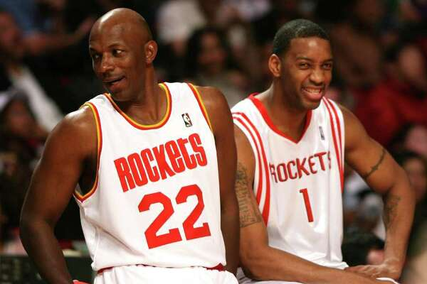 (l-r)Former Houston Rocket Clyde Drexler sits with Houston Rocket forward Tracy McGrady(cq) during All-Star Saturday's Shooting Stars Contest, February 18,2006 at the Toyota Center in Houston, Texas.(BILLY SMITH/STAFF)