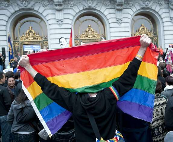 A man drapes himself with the rainbow flag in supporter of the overturning of Proposition 8 assemble at City Hall after marching down Market Street in San Francisco, Calif., on Wednesday, August 04, 2010. Photo: Chad Ziemendorf, The Chronicle