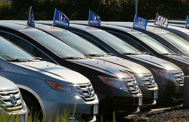SAN RAFAEL, CA - DECEMBER 02:  A row of brand new Honda Odysseys are displayed at Marin Honda on December 2, 2011 in San Rafael, California.  Honda Motor Co. announced today that they are recalling 304,000 vehicles around the globe for a possible airbag malfunction in Accord, Civic, Odyssey, Pilot, CR-V and other models that were manufactured between 2001 and 2002.  (Photo by Justin Sullivan/Getty Images) Photo: Justin Sullivan, Getty Images
