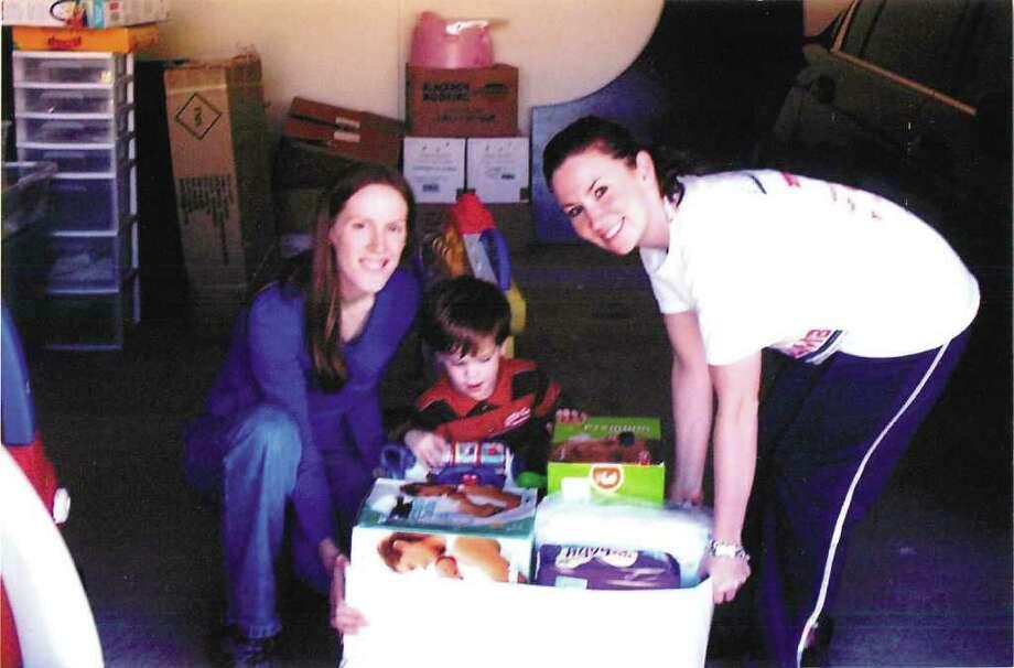 Shannon Elam, son Matthew Elam, and Betty Braun