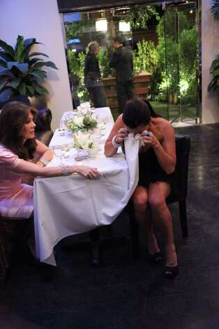 "Kyle Richards uses a tablecloth as a tissue when she breaks down with co-star Lisa Vanderpump on ""The Real Housewives of Beverly Hills."" Photo: Bravo / © Bravo"