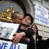 Same-sex couple Frank Capley-Alfano (L) and Joe Capley-Alfano kiss as they celebrate outside of San Francisco City Hall on February 7, 2012 in San Francisco, California. A three-judge panel of the 9th U.S. Circuit Court of Appeals ruled that the voter-approved Proposition 8 measure violates the civil rights of gay men and lesbians.