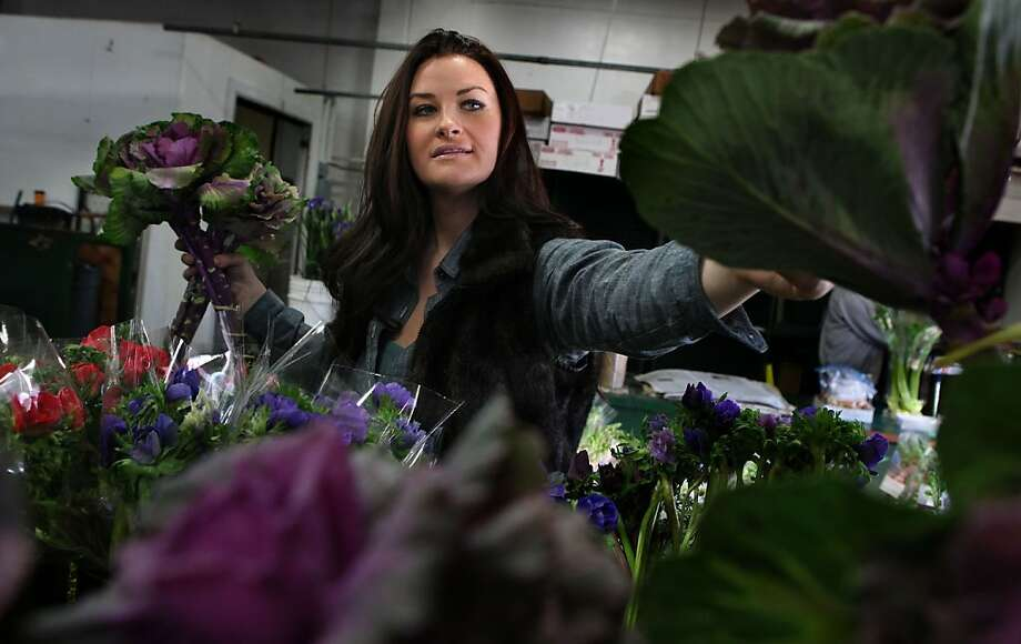 Eco-minded florist Christina Stembel of Farmgirl Flowers sourcing her flowers at the San Francisco Flower Mart in San Francisco, Calif., while looking at purple kale on Thursday, February 2, 2012.  She sources  locally grown flowers and plants. Photo: Liz Hafalia, The Chronicle