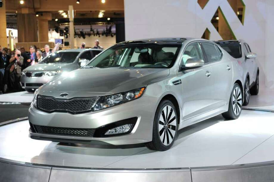 Best in Class: Kia Optima 2.0T EX 4dr ($25,850) Photo: STAN HONDA, AFP/Getty Images / 2010 AFP