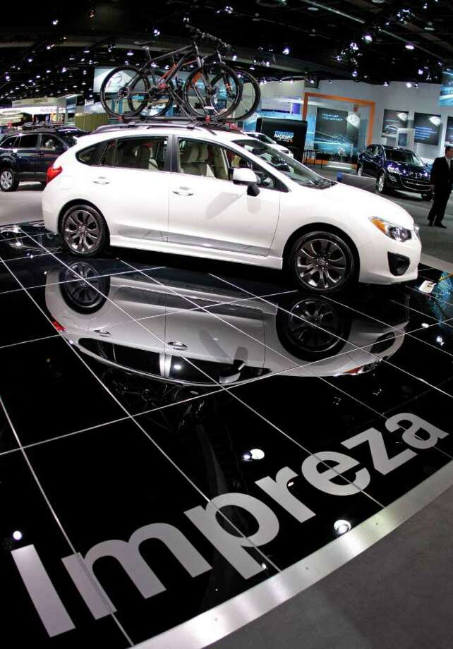 $20,000-$25,000 Best New Model: Subaru Impreza 2.0i Ltd AWD 4dr hatch ($22,845) Photo: Bill Pugliano, Getty Images / 2012 Getty Images
