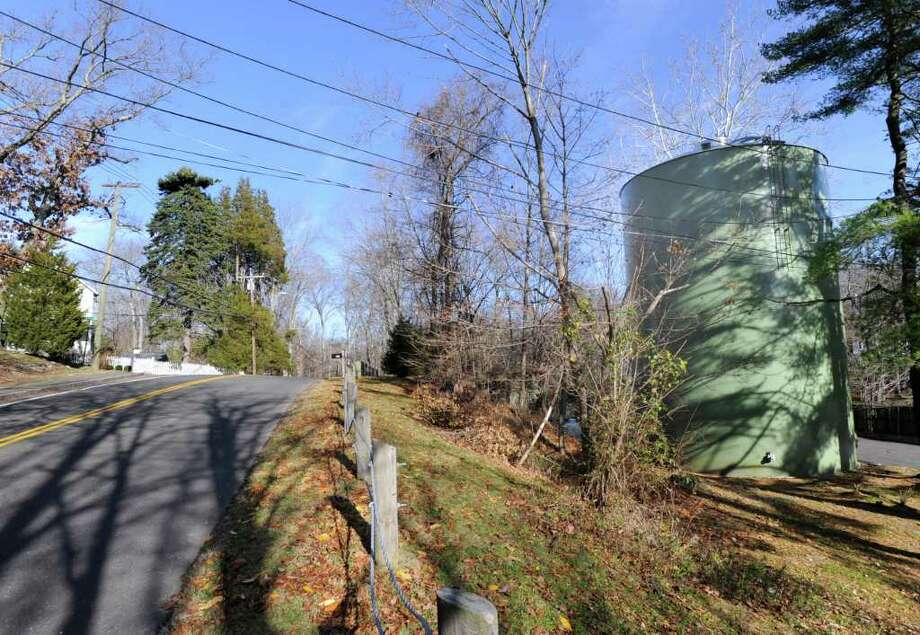 The Aquarion Water Co. water tower seen here, at right, on Valley Road in Greenwich, is the proposed site of a cell tower opposed by area residents. Photo: Bob Luckey, Greenwich Time File / Greenwich Time
