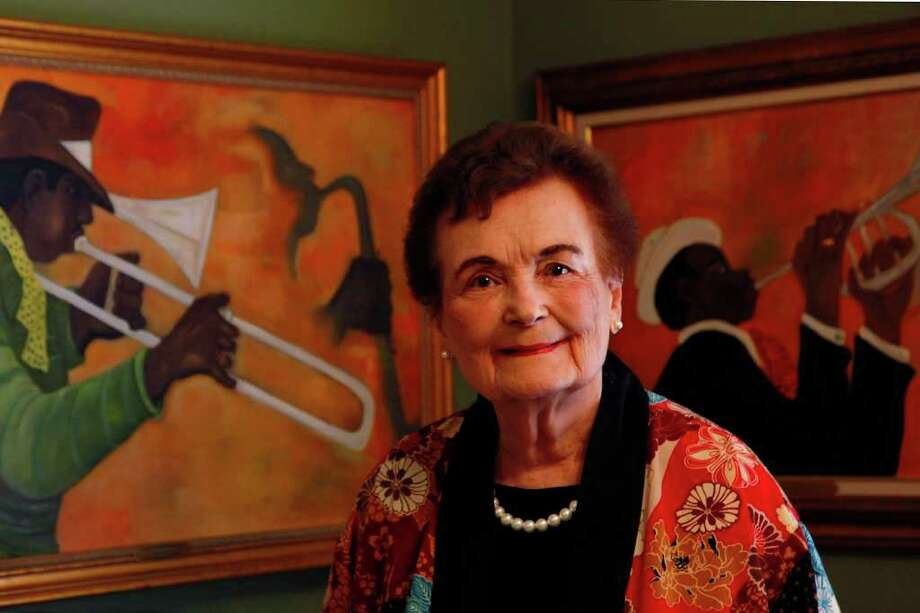 Former Mayor Lila Cockrell has over the years built an impressive collection of art by local and regional African American artists. John Coleman's paintings Trombonist and Jazz Man are in the background. Photo: Express-News File Photo / nfruge@express-news.net