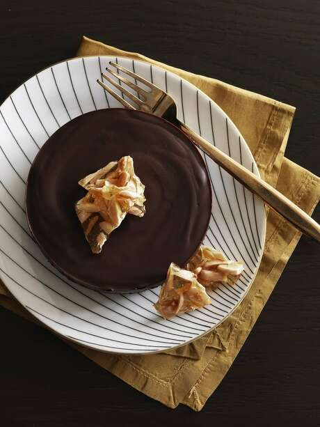 Delish0208: Redbook recipe for Chocolate Honey Almond Tarts. Photo: Jonny Valiant