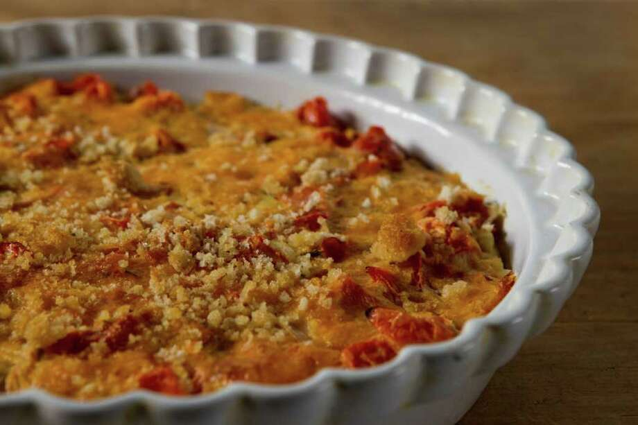 Tomato and Cheese Lunch Pie can be a side dish for dinner or enjoyed as a main dish anytime. Photo: Brett Coomer / © 2012 Houston Chronicle